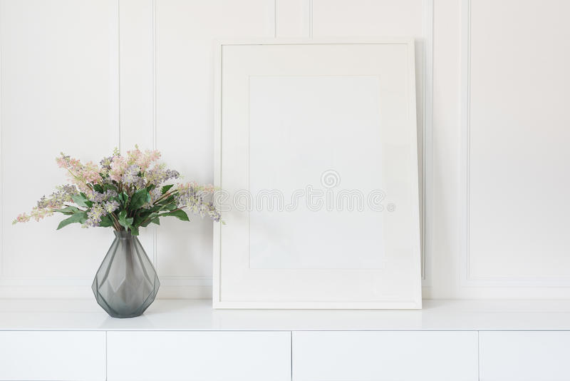 Glass vase of flower with white picture frame royalty free stock photos