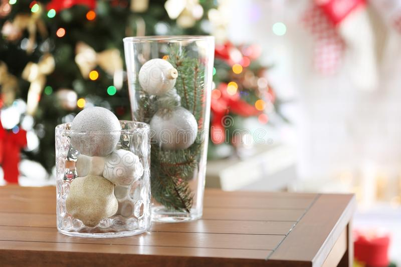 Glass vases with Christmas decoration on table. Glass vases with Christmas decoration on wooden table royalty free stock images