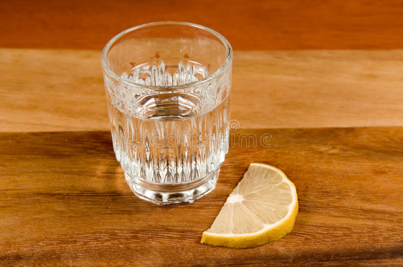 Download Glass of vodka and   lemon stock image. Image of board - 11676571