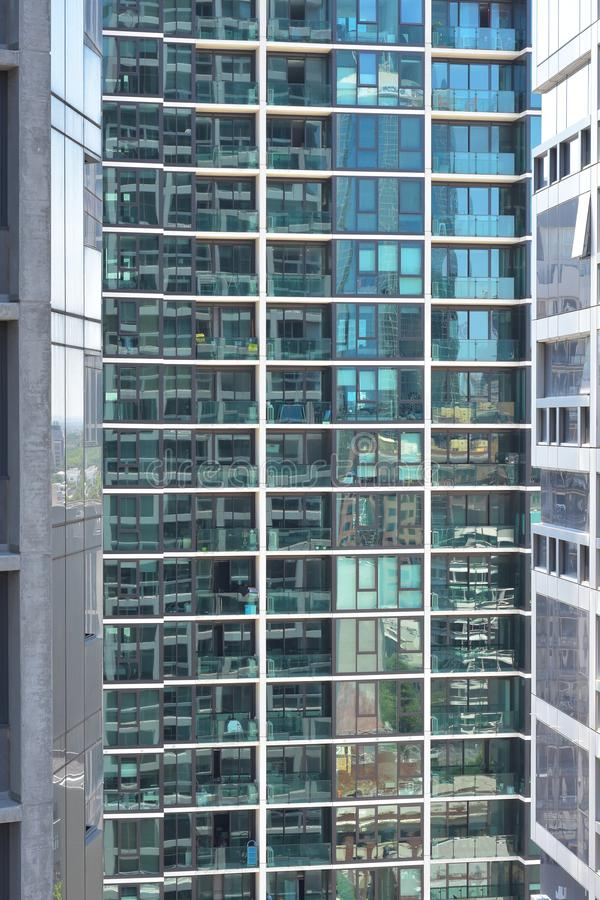 Glass wall with apartments and balconies royalty free stock photo