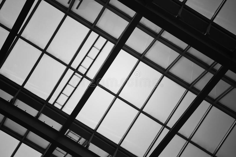 Glass wall or ceiling of building, black and white toned. For abstract background stock photos