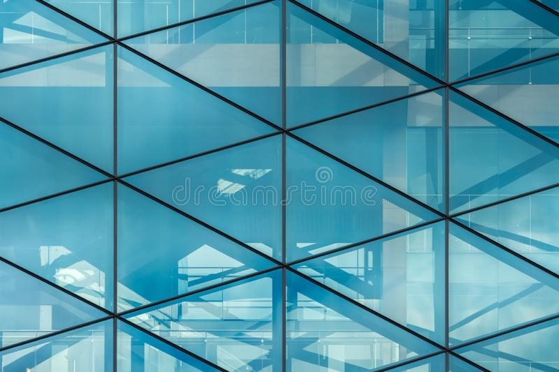 Glass wall with reflections in the office building stock photos