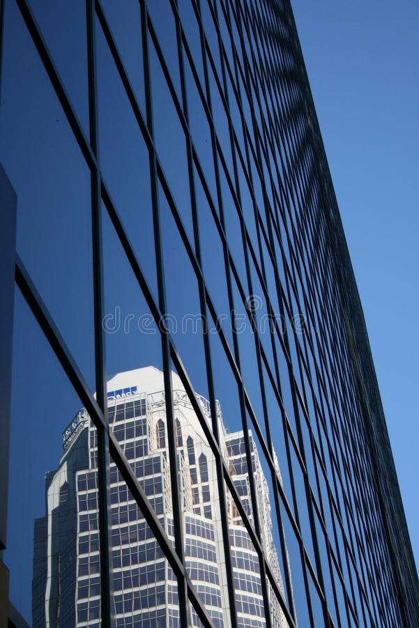 Glass wall of a skyscraper. Reflecting the image of another tall building, Montreal, Canada stock photography