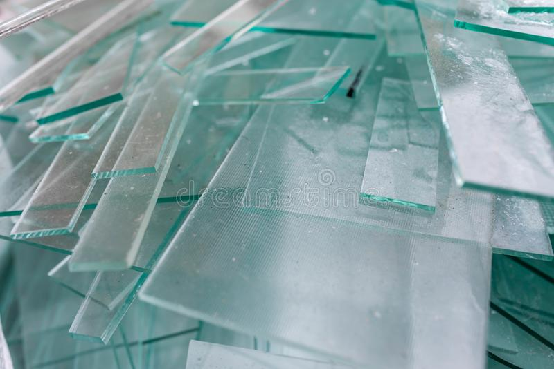 Glass waste sheets close up in containers , waiting the transport back to the factory royalty free stock photography