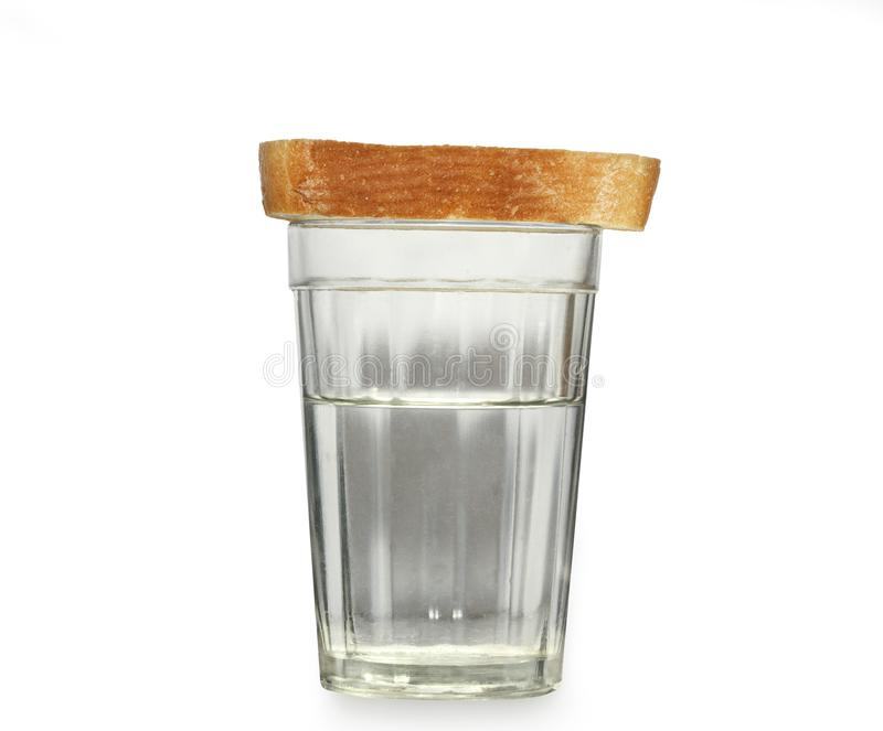 Glass of water and bread royalty free stock photo