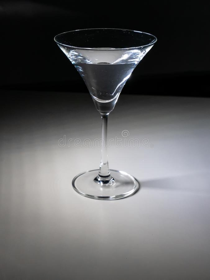 Glass of water with gradient background stock photo