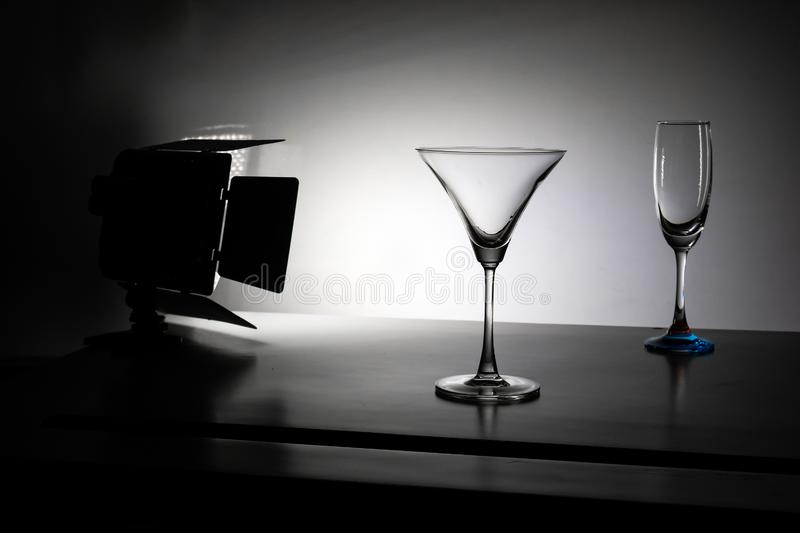 Two glasses of water with gradient background with studio light royalty free stock photography