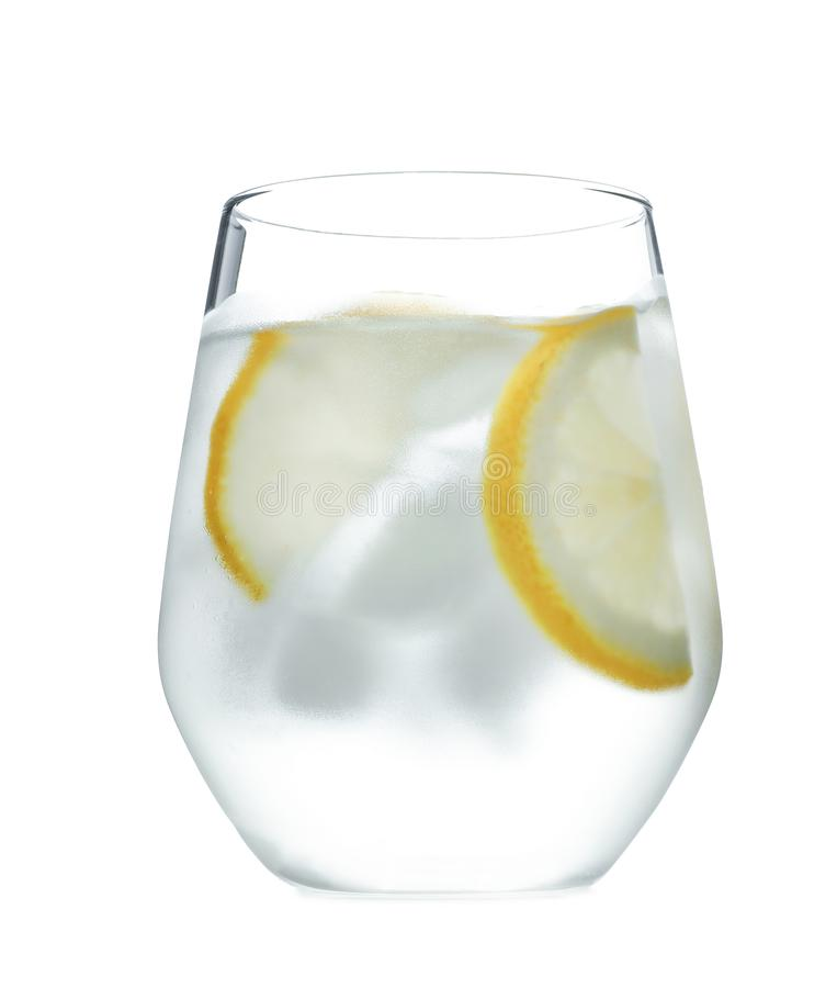 Glass of water with ice cubes and lemon slices on white background. Refreshing drink royalty free stock photo
