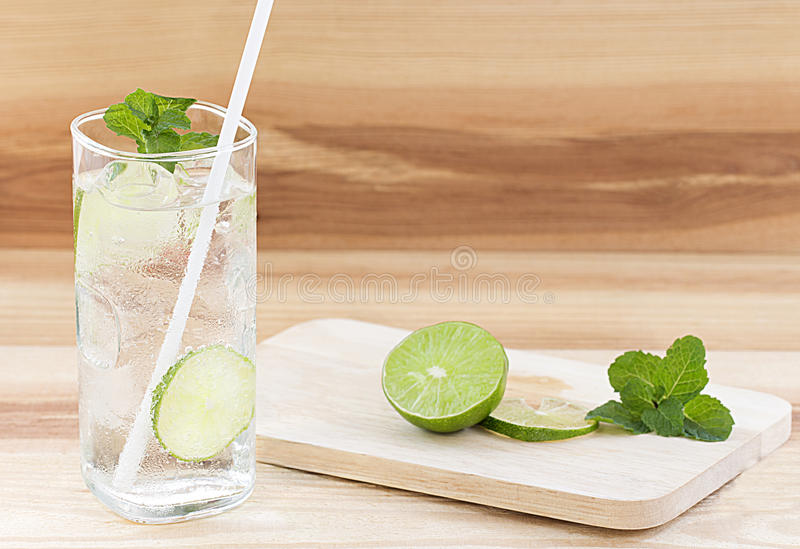 Glass of water with ice on table background stock image