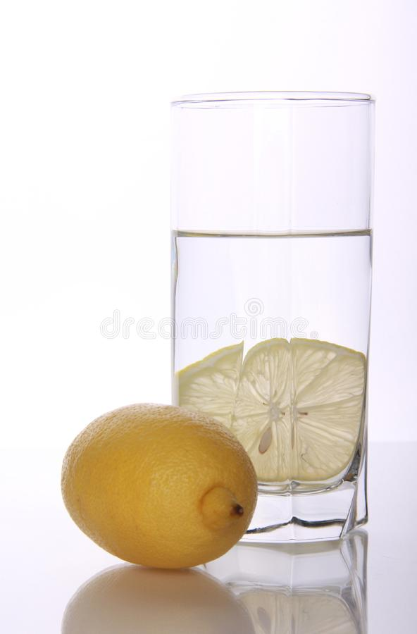 Glass with water and lemon royalty free stock images