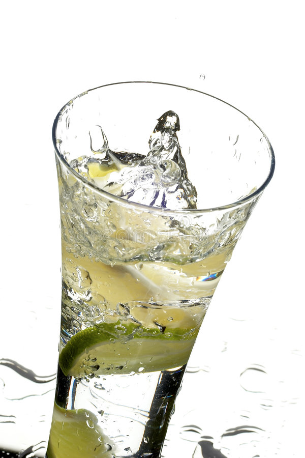 Glass with water and lemon stock photo