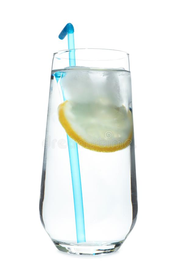 Glass of water with lemon, ice and straw on white background. Refreshing drink royalty free stock photography