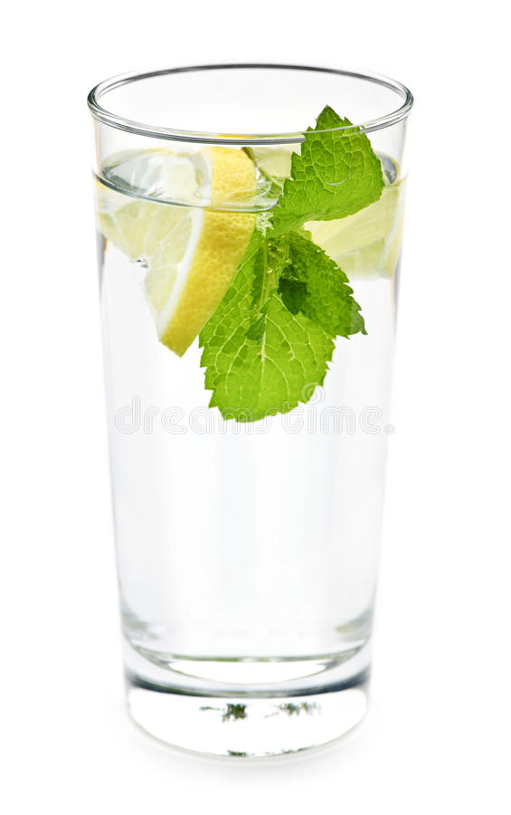 Glass of water with lemon and mint stock photography