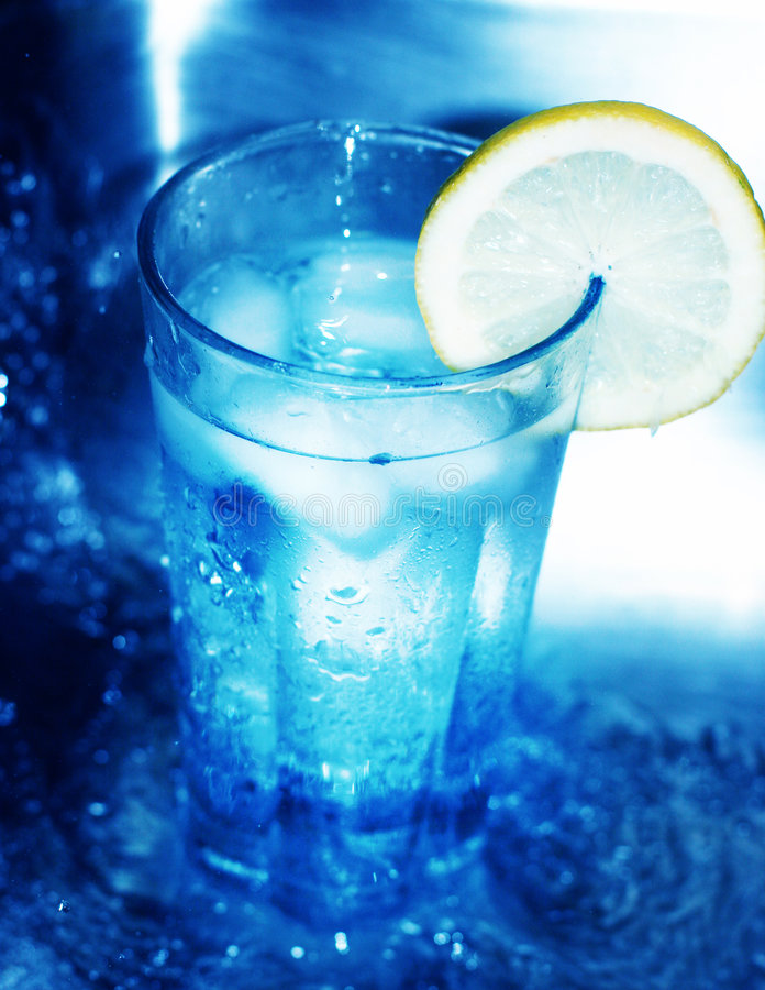 Glass of water with lemon slice stock photos