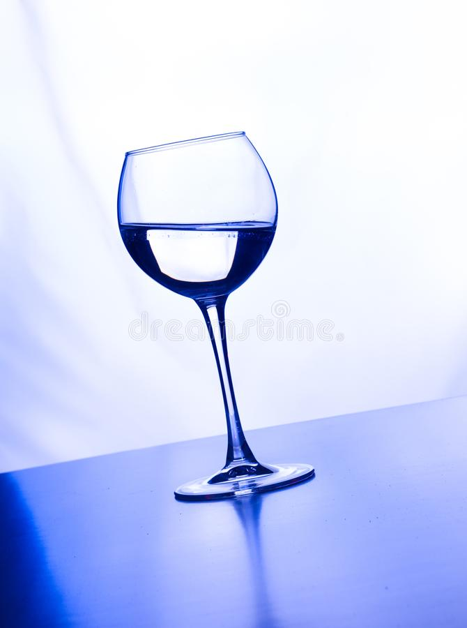 Glass water light splashes background with reflection stock photo