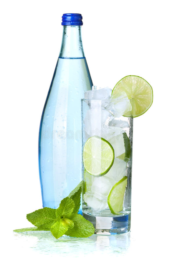Glass of water with lime and ice stock photos