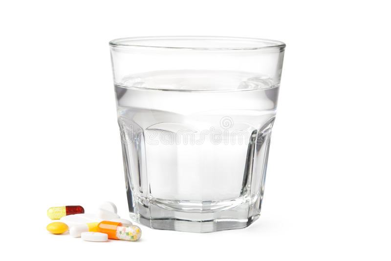 Glass of water and pills royalty free stock photos