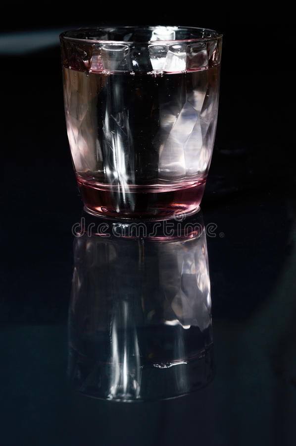 Glass of water and refleciton stock photo