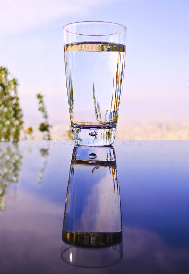 Glass With Water Reflection On Table Stock Image - Image ...