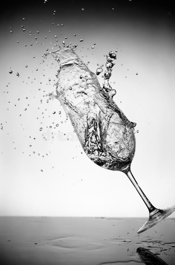 Glass and water splash stock photography
