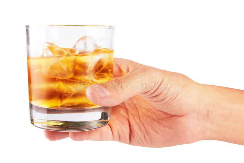 Glass of whiskey. Glass of whisky in hand isolated on a white stock photo