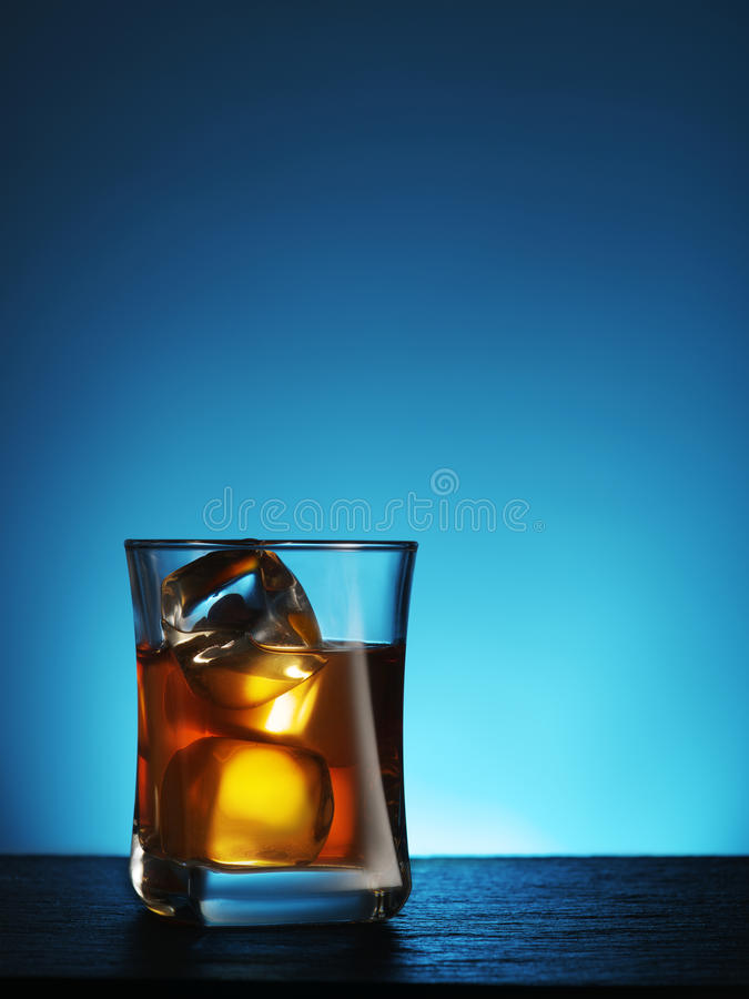 Glass of whiskey with ice. royalty free stock images