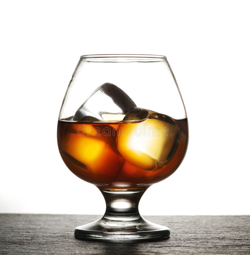 Glass of whiskey with ice. stock photography