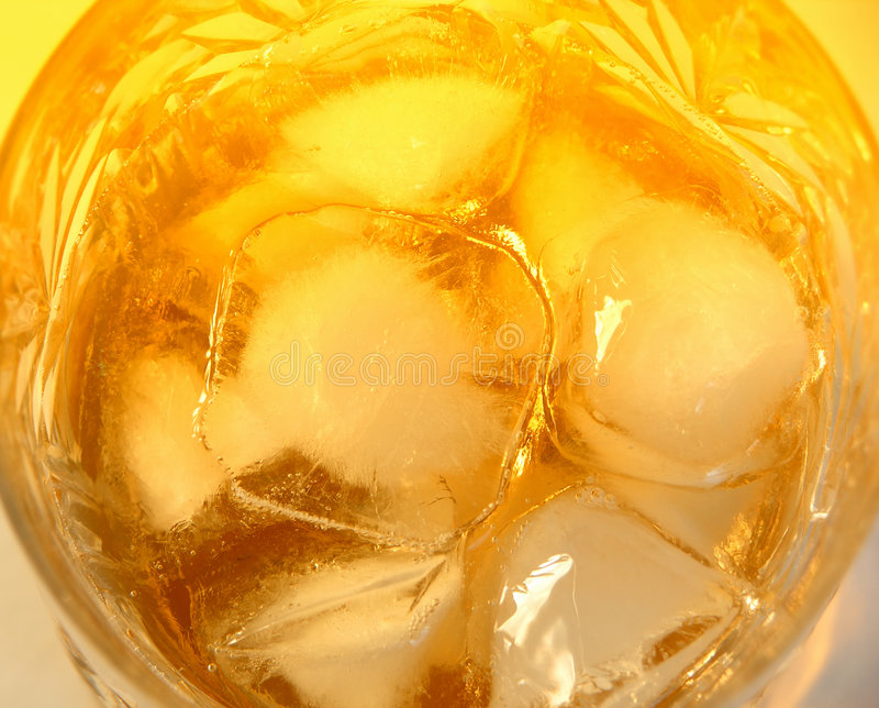 Glass of whiskey with rocks stock photo