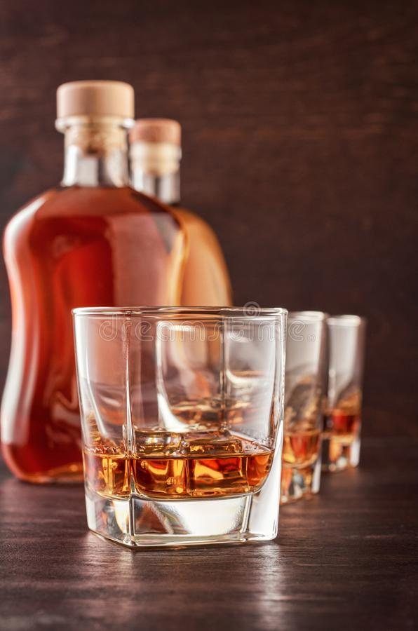 Glass of whiskey on a wooden table stock photo