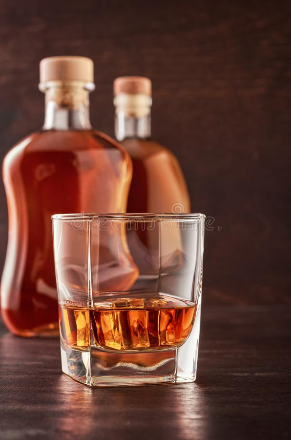 Glass of whiskey on a wooden table royalty free stock photos
