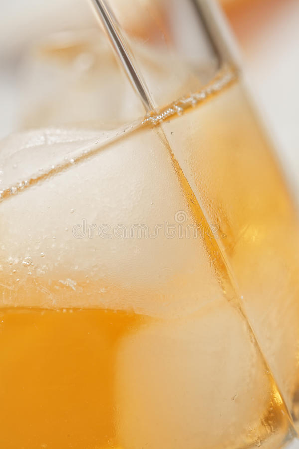 Glass of whisky closeup. Glass of whisky in rocks closeup photo royalty free stock photo