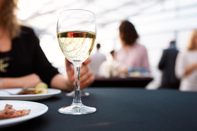 A glass of white and plates of food on a tray. A glass of white and plates of food standing on a tray during the buffet table royalty free stock image