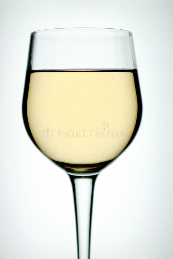 Glass on white wine royalty free stock images