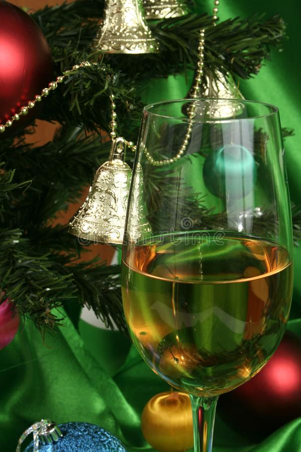 Glass of white wine on a beautiful christmas background stock photography