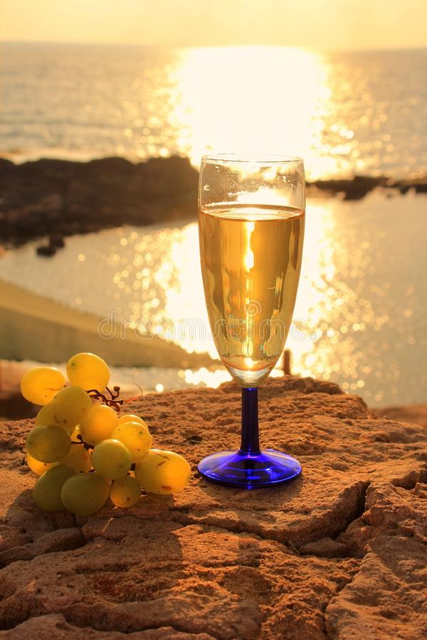Romantic landscape with glass of white wine stock images