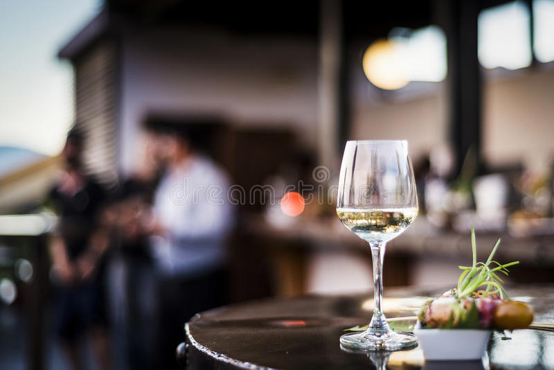 Glass of white wine with gourmet food tapa snacks outside. Glass of white wine with gourmet food tapa snacks in outdoors bar at sunset royalty free stock photos