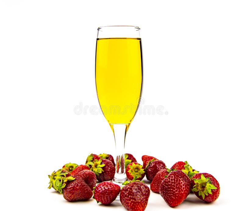 Glass of white wine and strawberries on a white background. Place for text royalty free stock photos