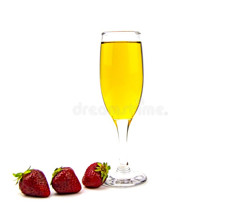 Glass of white wine and strawberries on a white background. Place for text royalty free stock image