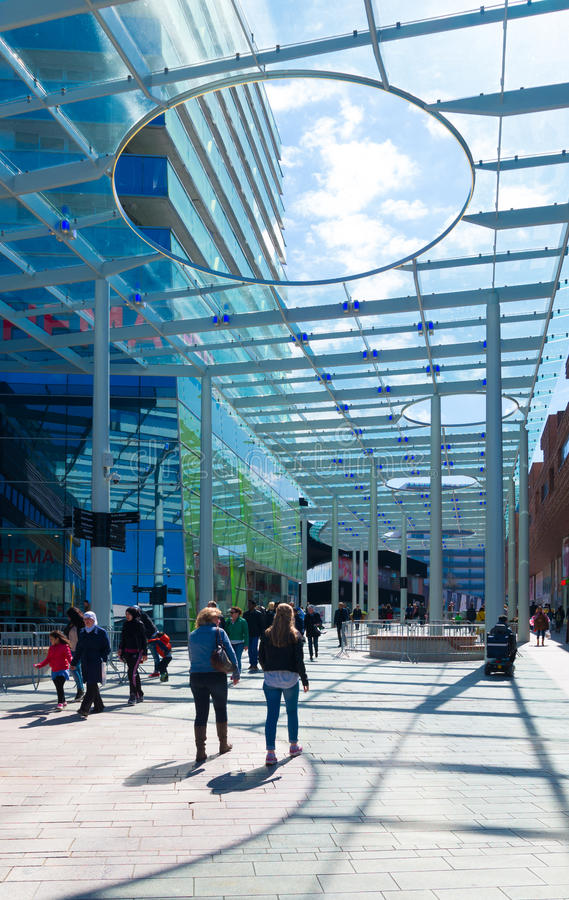 Glass wind canopy. ALMERE, NETHERLANDS - APRIL 18, 2015: Modern wind canopy. Its purpose is to protect the shopping people against the cold winds from the lake stock images