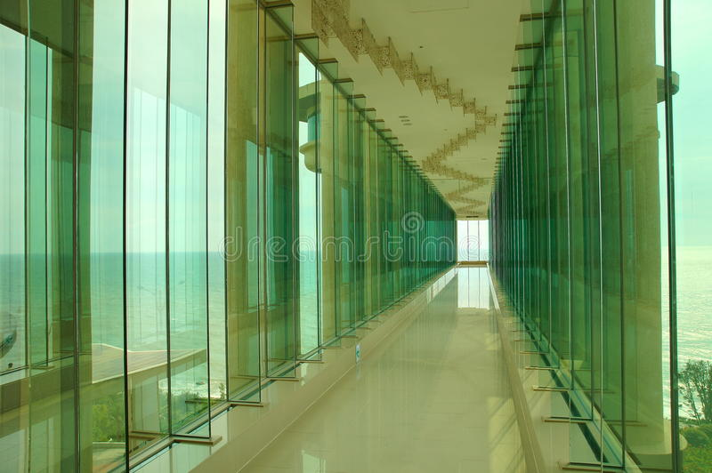 Glass window corridor. Endless glass window corridor toward sea royalty free stock photos