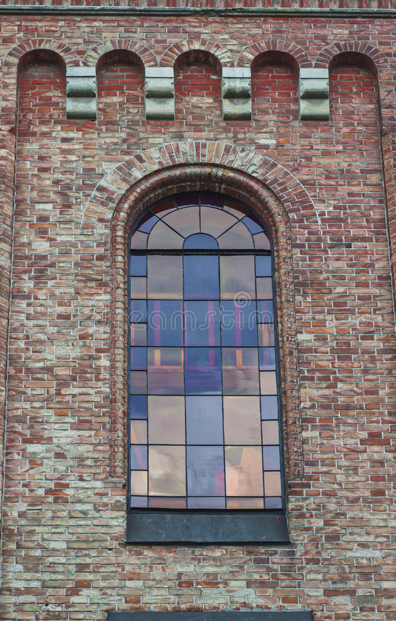 Glass window with stained-glass windows on the top of the church. A view from the bottom royalty free stock photos