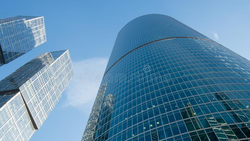 Glass windows of skyscrapers against the blue sky royalty free stock image