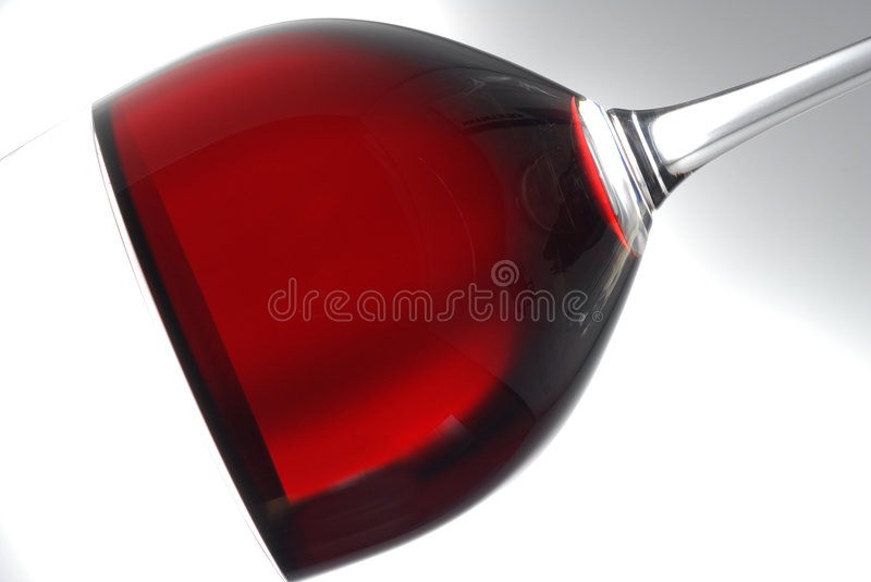 Glass Of Wine. Closeup of a glass of red wine, shot at an angle royalty free stock photography