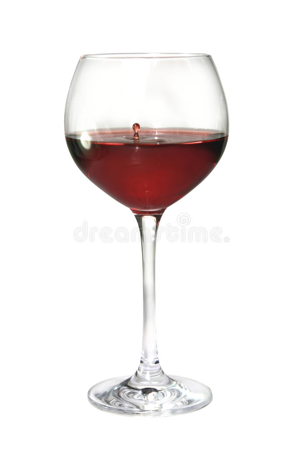 Glass of wine. A glass of red wine on white background. A drop of wine caught in midair royalty free stock images