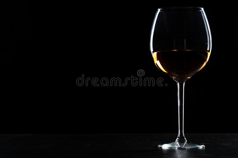 Glass of wine on a black background stock images