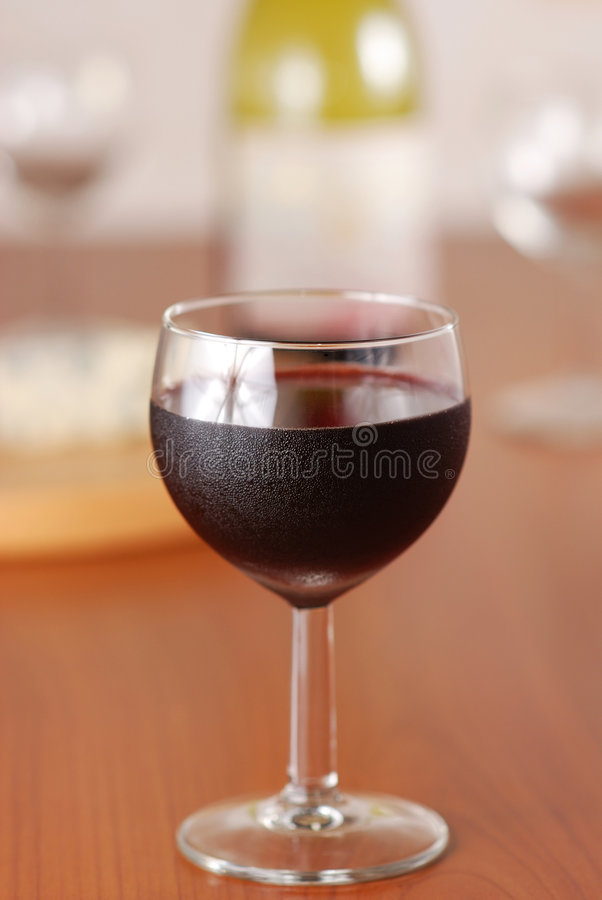 Glass of wine with bottle royalty free stock photo
