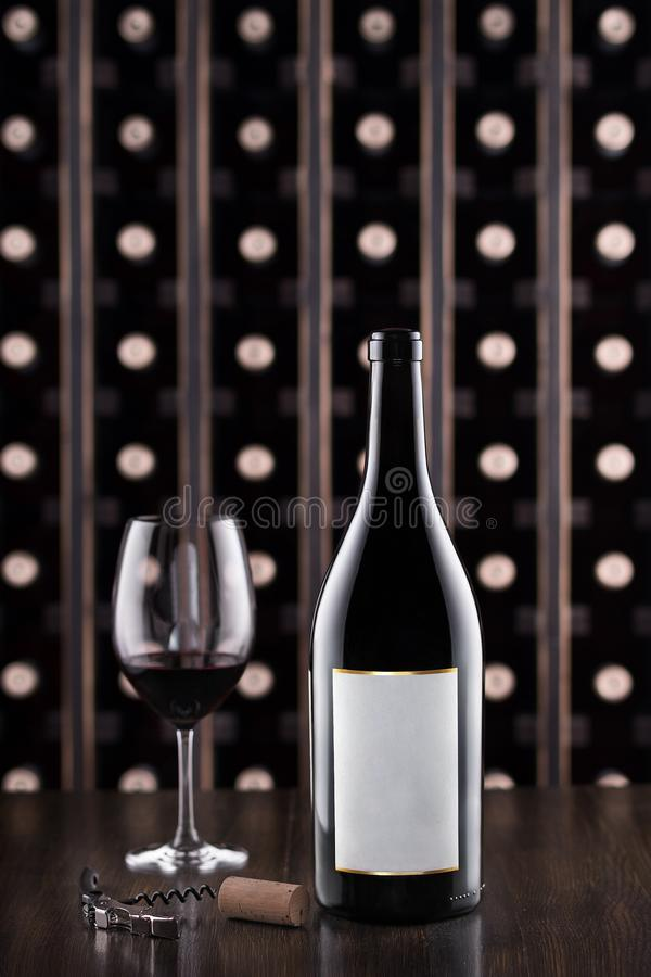 Glass of wine and wine bottle. Wine testing at the storage. Wine cellar. royalty free stock images