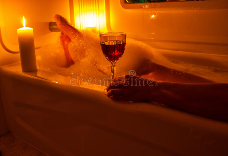A glass of wine and bubble bath royalty free stock image