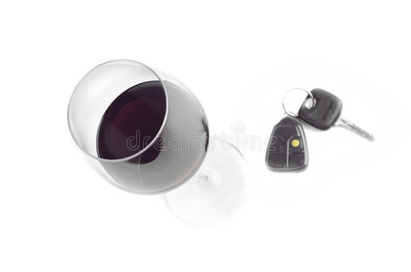 Glass Of Wine And Car Keys. On White Background royalty free stock photos