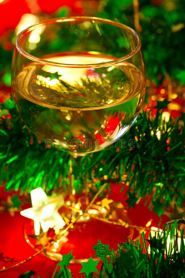 Glass of wine with Christmas decoration. Glass of white wine with Christmas decoration, very shallow DOF stock images